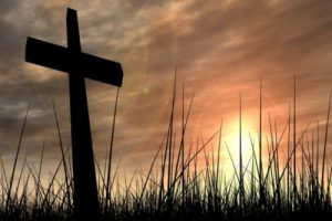 Silhouette of cross at sunset.