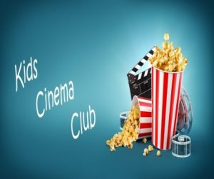 "Film clapper board, two cups of popcorn (one overturned) and some film reel, with words: ""Kids cinema club"""